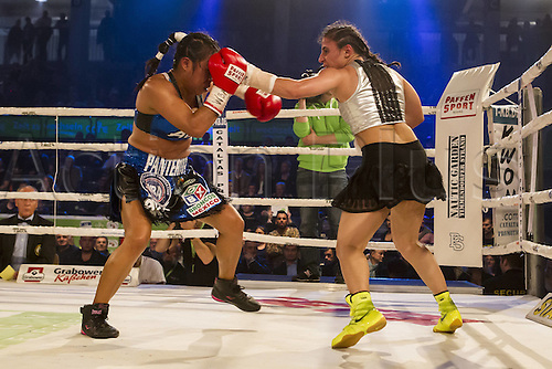 02.10.2015. Hamburg, Germany. Womens World Championship Boxing. WBA, WBO, WIBF Welterweight fight between Susi Kentikian (Germany) and Susana Cruz Perez (Mexico).  Susana Cruz Perez covers up as Susi Kentikian attacks