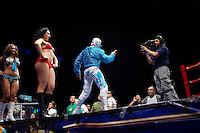 A Luchador (fighter) speaks to the camera before the start of a match, broadcast live on Tuesdays and Fridays. Lucha Libre is a style of wrestling started in Mexico in 1933. The name means Free Fight, and matches tend to be focussed on spectacle and theatre with fans cheering for their favourite characters, who wear masks while jumping from the ropes, flipping opponents, and occasionally crashing into the crowd..&copy;Jacob Silberberg/Panos/Felix Features.