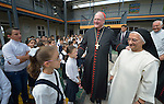 Cardinal Timothy Dolan, the archbishop of New York, visits with students displaced by war at the Al Bishara School run by the Dominican Sisters of St. Catherine of Siena in Ankawa, near Erbil, Iraq, on April 9, 2016. Accompanying him is Sister Huda Sheeto, the school's principal.<br /> <br /> Dolan, chair of the Catholic Near East Welfare Association, is in Iraqi Kurdistan with other church leaders to visit with Christians and others displaced by ISIS. The Dominican Sisters were themselves displaced by ISIS, and have established schools and other ministries among the displaced.<br /> <br /> CNEWA is a papal agency providing humanitarian and pastoral support to the church and people in the region.