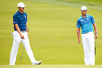 Zach Johnson (right) and Jordan Spieth wait to putt on the 1st green during the 2016 U.S. Open in Oakmont, Pennsylvania on June 16, 2016. (Photo by Jared Wickerham / DKPS)