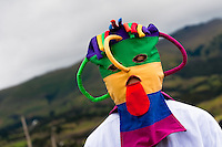 "A man dancer, wearing a colorful masque, performs Aya Uma - the creature from the Indian myths, during the Inti Raymi fiesta in Pichincha province, Ecuador, 26 June 2010. Inti Raymi, ""Festival of the Sun"" in Quechua language, is an ancient spiritual ceremony held in the Indian regions of the Andes, mainly in Ecuador and Peru. The lively celebration, set by the winter solstice, goes on for various days. The highland Indians, wearing beautiful costumes, dance, drink and sing with no rest. Colorful processions in honor of the God Inti (Sun) pass through the mountain villages giving thanks for the harvest and expressing their deep relation to the Mother Earth (Pachamama)."