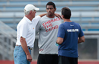 HEMPFIELD TOWNSHIP, PA - AUGUST 20:  Terrelle Pryor talks to quarterbacks coach Ken Anderson and agent Drew Rosenhaus prior to his pro day at a practice facility on August 20, 2011 in Hempfield Township, Pennsylvania.  (Photo by Jared Wickerham/Getty Images)