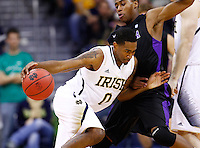 SOUTH BEND, IN - DECEMBER 21: Eric Atkins #0 of the Notre Dame Fighting Irish dribbles against Tahjere McCall #5 of the Niagara Purple Eagles at Purcel Pavilion on December 21, 2012 in South Bend, Indiana. (Photo by Michael Hickey/Getty Images) *** Local Caption *** Eric Atkins; Tahjere McCall