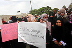 Palestinian women take part in a protest against what they say is frequent attacks on fishermen by the Israeli naval forces, in Gaza City September 30, 2012. Israel confines fishermen within a three-mile fishing zone in the Mediterranean Sea off the coast of Gaza, Palestinian fishermen syndicate said. A Palestinian man died on September 29 after he was shot by Israeli troops while fishing on the beach in the Gaza Strip, said Hamas officials, while an Israeli military spokeswoman said the man was shot when he approached the border fence. Photo by Ashraf Amra