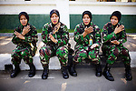 In Aceh Province, a special unit in the Women's Army Corps, of the Indonesian military, is the only unit for women in the military to wear fatigues in the country, in Banda Aceh, Indonesia, on Wednesday, Dec. 15, 2010. They participate in search and rescue, women's issues, and trauma.