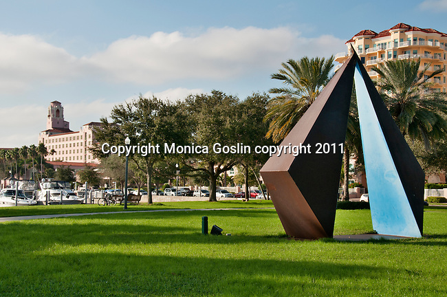 The Vinoy Park in St. Petersburgh, Florida with a sculpture by Rolf Brommelsick (made in 1980) titled Truth and the Vinvoy Hotel in the background (pink building)