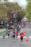 Runners run past the historical Corner area during the Charlottesville 10 miler running race in Charlottesville, Va.  Photo/Andrew Shurtleff