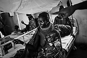 25 year old Kopotea Educon (centre) seen here with her malnutritioned infant, 9 month old Emojong at the stabilization centre of the Lokitaung District Hospital in the Turkana region of northwestern Kenya. Photo: Sanjit Das/Panos