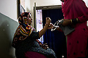 A young pregnant woman visits the local dai for a medical check up. <br />
