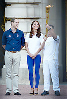 Prince William and Catherine, Duchess of Cambridge welcome the olympic torch to Buckingham Palace, London, UK. July 26, 2012..Picture: Catchlight Media / Featureflash