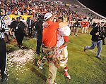 Lafayette High's Tevin Buford (11) hugs Lafayette High head coach Anthony Hart vs. Laurel in the MHSAA Class 4A championship game at Mississippi Veterans Memorial Stadium in Jackson, Miss. on Saturday, December 3, 2011. Lafayette won 39-29, the team's 32 straight win, to capture their second consecutive state championship.