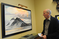 NWA Democrat-Gazette/FLIP PUTTHOFF <br /> An art work in Bailey's office shows      Nov. 11, 2015 a volcano in South America.