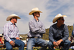 Three cowboys sit on the fence and watch the actionJordan Valley Big Loop Rodeo, Ore.