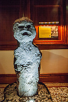 A stone carving of the Hawaiian deity Kaneikokala, Bishop Museum, Honolulu, O'ahu.