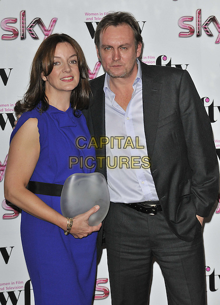 The Barclays Corporate Business Award winner Sarah Cooper & Philip Glenister.attended the Women in Film & TV Awards 2011, London Hilton hotel, Park Lane, London, England, UK, .2nd December 2011..half length blue dress shirt grey gray suit award trophy .CAP/CAN.©Can Nguyen/Capital Pictures.
