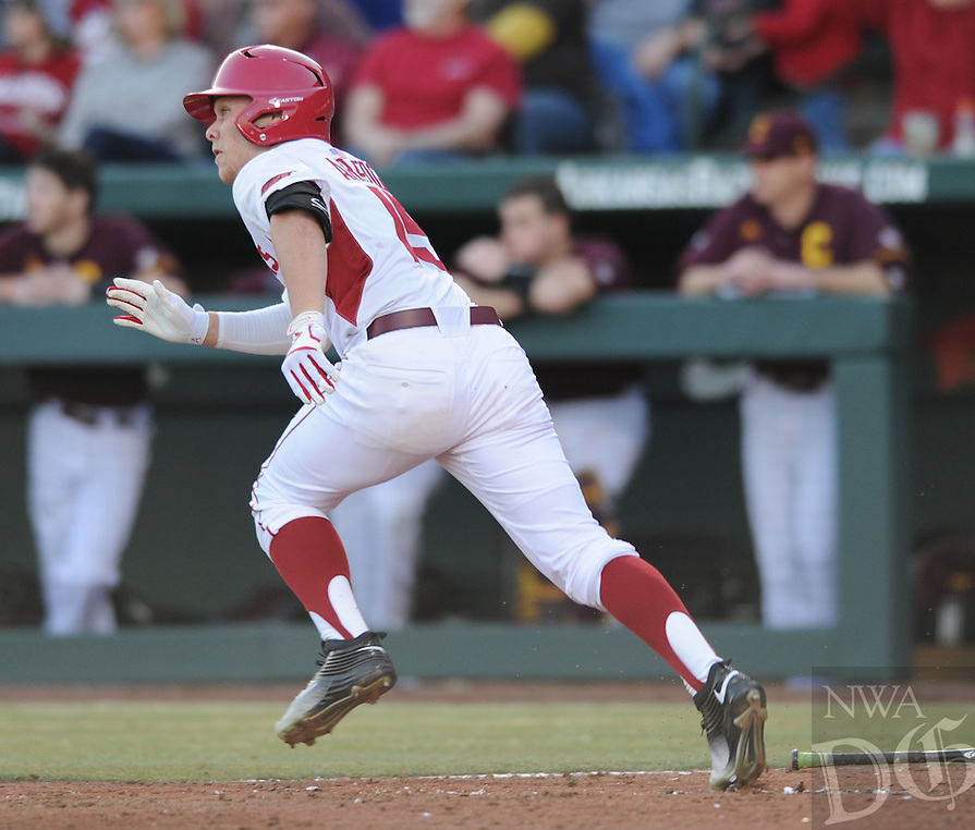 NWA Democrat-Gazette/ANDY SHUPE<br />Jake Arledge of Arkansas heads to first after hitting an RBI triple against Central Michigan Friday, Feb. 19, 2016, during the eighth inning at Baum Stadium in Fayetteville. Visit nwadg.com/photos to see more photographs from the game.