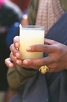 Tibetans singing drinking chang beer during Losar, Tibetan New Year celebration.