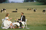 Glyndebourne Opera House. Near Lewes, Sussex, England. A couple enjoy an alfresco supper during the opera interval.