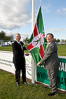 Lord Lieutenant of Nottinghamshire Sir Andrew Buchanan (left) and President of the Newark & Nottinghamshire Agricultural Society Mitch Stevenson OBE  raise the flag to start the show at Friday night's dinner.