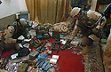 U.S. Army soldiers from the 82nd Airborne 1st Battalion 505th Regiment secure bomb making materials, weapons and insurgent training materials during an October 31, 2003 cordon and search operation through three houses in the town of Fallujah, Iraq.