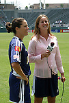 27 June 2004: Julie Foudy (left) talks to Brandi Chastain (right) who worked the game as a television commentator. The San Diego Spirit defeated the Carolina Courage 2-1 at the Home Depot Center in Carson, CA in Womens United Soccer Association soccer game featuring guest players from other teams.