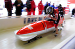 18 December 2010: Heath Spence pushes his 2-man bobsled for Australia, finishing in 16th place at the Viessmann FIBT World Cup Bobsled Championships on Mount Van Hoevenberg in Lake Placid, New York, USA. Mandatory Credit: Ed Wolfstein Photo