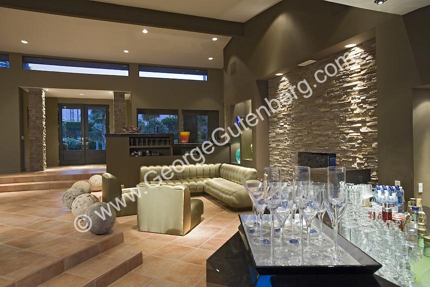 Stock photo of wetbar overlooking living room stock for Wet bar in living room