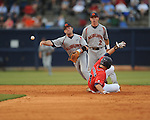Auburn's Casey McElroy (23) forces out Mississippi's Tim Ferguson (4) and throws to first for a double play to get out of a bases loaded jam during a college baseball game in Oxford, Miss. on Thursday, May 20, 2010.  (AP Photo/Oxford Eagle, Bruce Newman)