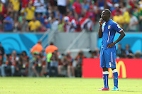 Mario Balotelli of Italy shows a look of dejection after Bryan Ruiz of Costa Rica scores the opening goal, 1-0