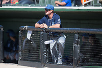 Asheville Tourists pitching coach Ryan Kibler (9) watches from the dugout during the game against the Kannapolis Intimidators at Kannapolis Intimidators Stadium on May 7, 2017 in Kannapolis, North Carolina.  The Tourists defeated the Intimidators 4-1.  (Brian Westerholt/Four Seam Images)