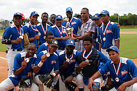 The blue team of Torneo Supremo pose for a picture after winning the championship in Boca Chica August 8, 2011 the tournament called Torneo Supremo which aims to maximize the ability of Major League Baseball organizations to scout in the Dominican Republic. El Torneo Supremo will consist of four teams playing one game per week in addition to a mid-tournament All-Star event, as well as championship and consolation games. Tournament participants will also be provided in-classroom education opportunities. April 2011. ViewPress/ ZZ