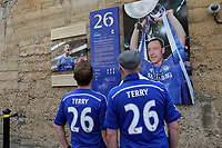 A couple of Chelsea fans study the tribute to John Terry on the old 'Shed Wall' outside the ground during Chelsea vs Sunderland AFC, Premier League Football at Stamford Bridge on 21st May 2017