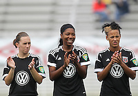 BOYDS, MARYLAND - July 21, 2012:  Mikaela Howell (8), Tiffany Brown (9), Lianne Sanderson (10) of DC United Women before playing against the Virginia Beach Piranhas during a W League Eastern Conference Championship semi final match at Maryland Soccerplex, in Boyds, Maryland on July 21. DC United Women won 3-0.