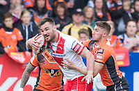 Picture by Allan McKenzie/SWpix.com - 13/05/2017 - Rugby League - Ladbrokes Challenge Cup - Castleford Tigers v St Helens - The Mend A Hose Jungle, Castleford, England - St Helens's Luke Douglas is tackled by Castleford's Glen Minikin.