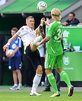 FUSSBALL   1. BUNDESLIGA   SAISON 2011/2012    2. SPIELTAG VfL Wolfsburg - FC Bayern Muenchen      13.08.2011 Bastian SCHWEINSTEIGER (li, Bayern) gegen Simon KJAER (re, Wolfsburg)