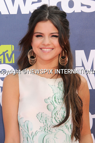 "SELENA GOMEZ.attends the 2011 MTV Movie Awards at the Gibson Amphitheatre on June 5, 2011 in Universal City, California.Mandatory Photo Credit: ©Crosby/Newspix International. .**ALL FEES PAYABLE TO: ""NEWSPIX INTERNATIONAL""**..PHOTO CREDIT MANDATORY!!: NEWSPIX INTERNATIONAL(Failure to credit will incur a surcharge of 100% of reproduction fees)..IMMEDIATE CONFIRMATION OF USAGE REQUIRED:.Newspix International, 31 Chinnery Hill, Bishop's Stortford, ENGLAND CM23 3PS.Tel:+441279 324672  ; Fax: +441279656877.Mobile:  0777568 1153.e-mail: info@newspixinternational.co.uk"