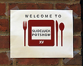 A sign welcoming people to Slideluck Potshow XV NYC at the Tobacco Warehouse in the DUMBO section of Brooklyn.<br />