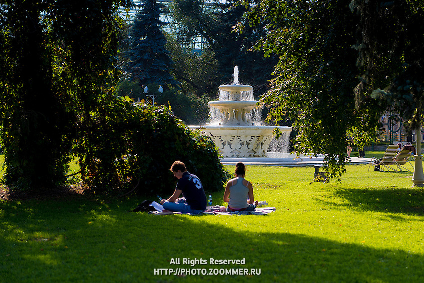 Couple picnicing in Gorky park, Moscow Russia