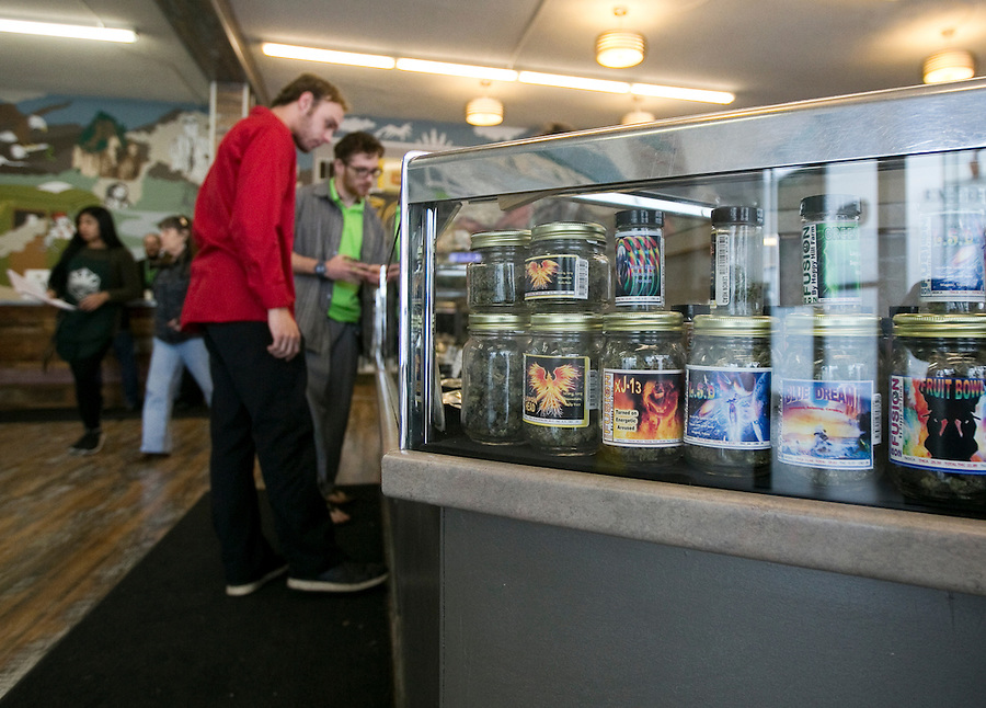 Customers peruse products in a case at Main Street Marijuana in downtown Vancouver February 14, 2017. (Photo by Natalie Behring for the Columbian)