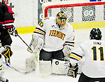 29 December 2010: University of Vermont Catamount goaltender Alex Vazzano, a Freshman from Trumbull, CT, makes a third period save against the 2011 U.S. Men's National University Team in an exhibition game at Gutterson Fieldhouse in Burlington, Vermont. The Catamounts defeated the National team 7-1. Mandatory Credit: Ed Wolfstein Photo