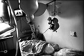 Wroclaw 02.02.2007 Poland<br /> Izabela Rus, 5, sleep in her room.<br /> Clinical Hospital, oncology and haematology departmend. This is one of the important Haematologic Hospital in all over Poland, however hospital board stopped to discharge a rising debt. In this connection authorities must close hospital, but goverment had no idea what should do with terminaly ill children<br /> (Photo: Adam Lach / Napo Images)<br /> <br /> Izabela Rus ( 5 lat ) spi w swojej sali.<br /> Akedemicki Szpital Kliniczny, oddzial onkologii i hematologii. Temu jednemu z najwazniejszych w Polsce osrodkowi szpitalnemu grozi zamkniecie w powodu dlugow, ktore niezaleznie od wplat NFZ-tu regularnie sciaga komornik. Z calej Polski ludzie charytatywnie wplacaja pieniadze by uratowac szpital i los dzieci dla ktorych to miejsce jest jedynym ratunkiem.