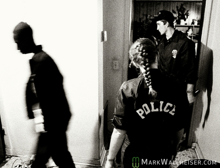 A suspect walks away from Tallahassee crack-squd officers after questioning during a crack raid at a crack house.