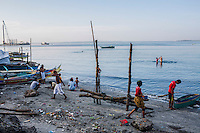 Badjao tribal sea-people, survivors of the Zamboanga City rebel attack continue to fish as they take refuge around the city's largest stadium in Zamboanga, Mindanao, The Philippines on November 4, 2013. These Internally Displaced People (IDP) had taken refuge along the Boulevard tourist street after surviving the 3 week long attack by MNLF rebels. Photo by Suzanne Lee for SPRINT-IPPF