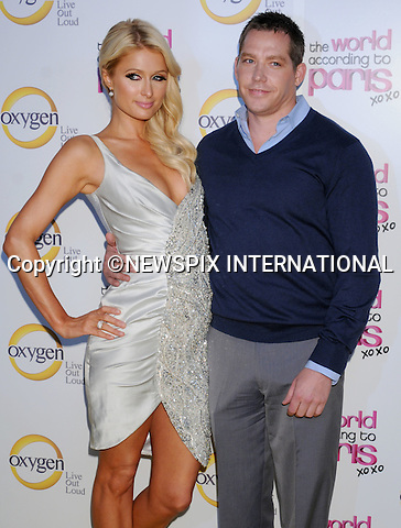 """Paris Hilton and Cy Waits.arrives at """"The World According to Paris"""" Premiere Party at the Tropicana Bar at the Hollywood Roosevelt Hotel on May 17, 2011 in Hollywood, California..Mandatory Photo Credit: ©Crosby/Newspix International..**ALL FEES PAYABLE TO: """"NEWSPIX INTERNATIONAL""""**..PHOTO CREDIT MANDATORY!!: NEWSPIX INTERNATIONAL(Failure to credit will incur a surcharge of 100% of reproduction fees)..IMMEDIATE CONFIRMATION OF USAGE REQUIRED:.Newspix International, 31 Chinnery Hill, Bishop's Stortford, ENGLAND CM23 3PS.Tel:+441279 324672  ; Fax: +441279656877.Mobile:  0777568 1153.e-mail: info@newspixinternational.co.uk"""