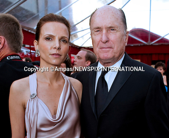 """ROBERT DUVALL AND LUCIANA PEDRAZA.arrives at the 82nd Annual Academy Awards at the Kodak Theatre in Hollywood, CA, on Sunday, March 7, 2010..Mandatory Photo Credit: Newspix International..**ALL FEES PAYABLE TO: """"NEWSPIX INTERNATIONAL""""**..PHOTO CREDIT MANDATORY!!: NEWSPIX INTERNATIONAL(Failure to credit will incur a surcharge of 100% of reproduction fees)..IMMEDIATE CONFIRMATION OF USAGE REQUIRED:.Newspix International, 31 Chinnery Hill, Bishop's Stortford, ENGLAND CM23 3PS.Tel:+441279 324672  ; Fax: +441279656877.Mobile:  0777568 1153.e-mail: info@newspixinternational.co.uk"""