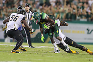 Tampa, FL - September 2, 2016: South Florida Bulls wide receiver Rodney Adams (87) gets tackled during game between Towson and USF at the Raymond James Stadium in Tampa, FL. September 2, 2016.  (Photo by Elliott Brown/Media Images International)