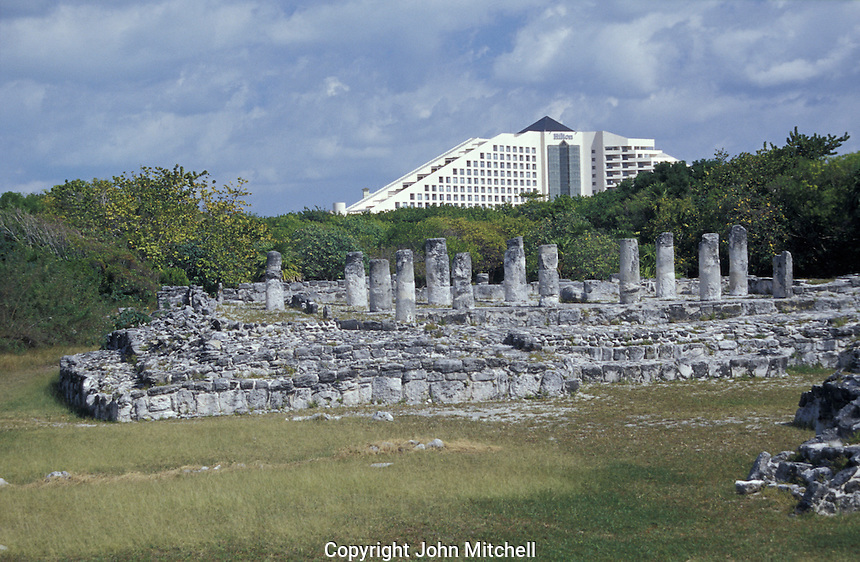 The Mayan ruins of El Rey with Hotel Hilton in background, Cancun, Mexico