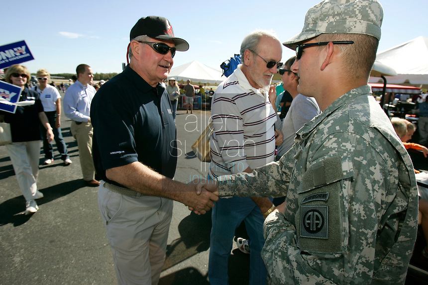 Georgia Governor Sonny Perdue greets Pvt. Gerald White of the 82nd Airborne at The Great Georgia Airshow at Falcon Field Airport in Peachtree City, Ga. on Sunday, Oct. 15, 2006.<br />
