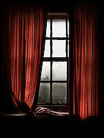 Window with orange curtains
