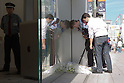 October 6, 2011: Tokyo, Japan - Foreign media look closely at the flowers left the late Steve Jobs, founder and former CEO of Apple Inc., outside the Apple store in the Ginza shopping district of Tokyo. Jobs passed away in the United States at the age of 56 after a long battle with cancer. (Photo by Christopher Jue/AFLO)